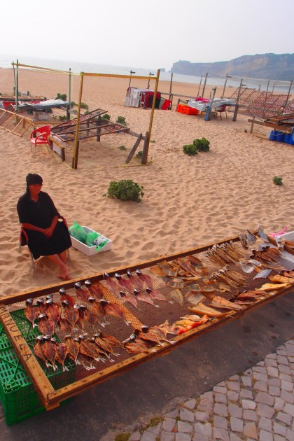 Grandma selling various dried fish in Nazare